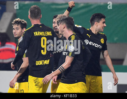 Magdeburg, Germany. 24th Oct, 2017. Dortmund's Marc Bartra celebrates his 4-0 score with his teammates during the - Stock Photo
