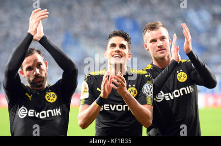 Magdeburg, Germany. 24th Oct, 2017. Dortmund's players Gonzalo Castro, Marc Bartra and Andrey Yarmolenko celebrate - Stock Photo