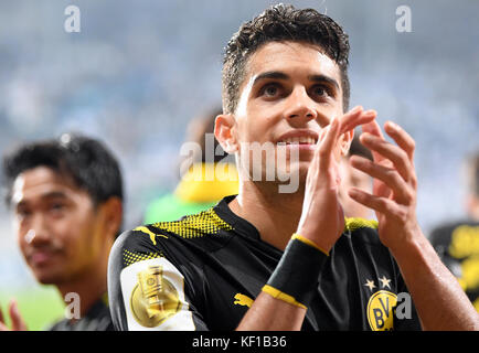 Magdeburg, Germany. 24th Oct, 2017. Dortmund's Marc Bartra celebrates the team's 5-0 win after the DFB Cup soccer - Stock Photo
