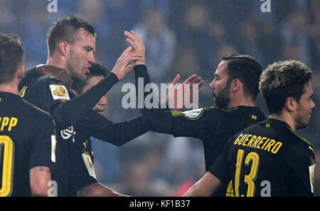 Magdeburg, Germany. 24th Oct, 2017. Dortmund's Andrey Yarmolenko (2-L) celebrates his 3-0 score with his teammates - Stock Photo