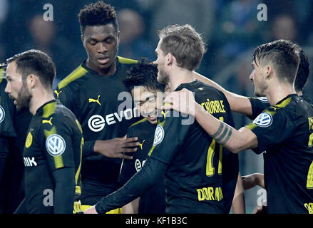Magdeburg, Germany. 24th Oct, 2017. Dortmund's Shinji Kagawa cheers over the 5-0 score with his teammates during - Stock Photo
