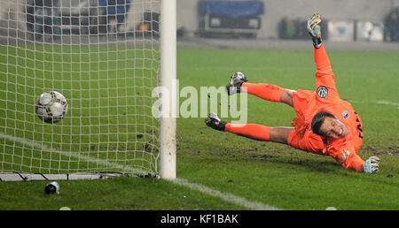Magdeburg, Germany. 24th Oct, 2017. Magdeburg's goalkeeper Alexander Brunst fails to save the 3-0 penalty score - Stock Photo