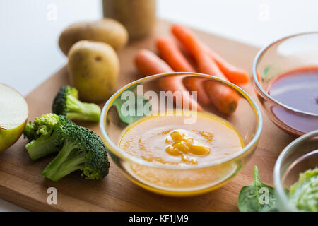 vegetable puree or baby food in glass bowl - Stock Photo