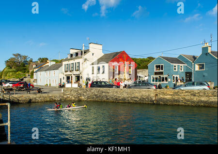 Crookhaven, West Cork, Ireland on a summers day with children playing in water and lots of tourists with copy space. - Stock Photo