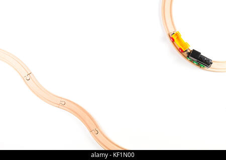 Toy train on round wooden railways - Stock Photo