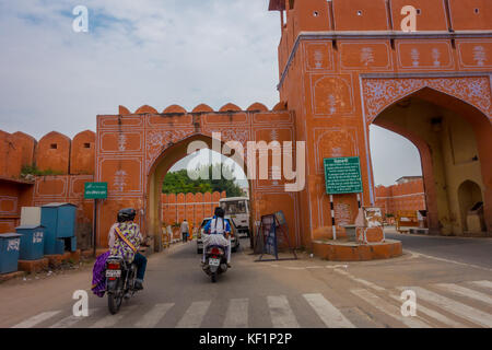 JAIPUR, INDIA - SEPTEMBER 19, 2017: Unidentified people crossing in motorcycles the entrance gates to the city in - Stock Photo