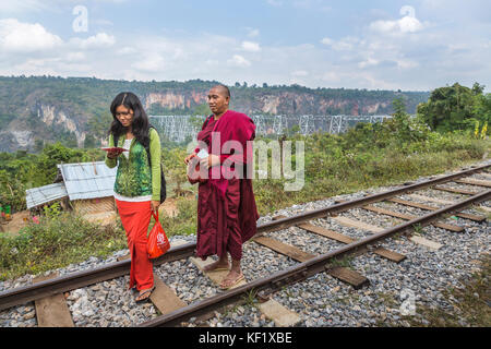 Monk and young woman on the railway line at the Goteik (Goke Hteik) viaduct, a railway trestle in Nawnghkio between - Stock Photo