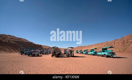 Shuttle trucks waiting for tourists in Upper Antelope Canyon, Arizona, October 9, 2017. - Stock Photo