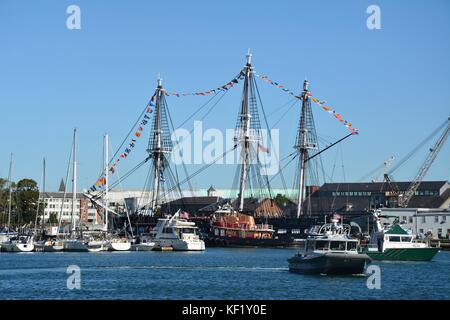 The historic USS Constitution sailing in Boston Harbor after a series of repairs and restoration projects at the - Stock Photo