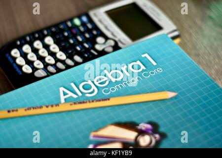 Algebra math book on desk next to classroom materials Stock Photo ...