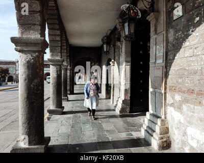 Indigenous woman walking by Ayacucho Plaza de Armas / Casona Boza y Solís - Stock Photo