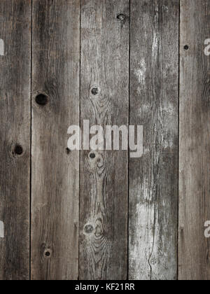 Rustic silver grey weathered barn wood board background showing rich grain and knots - Stock Photo