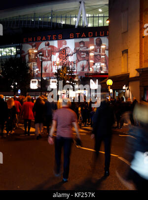 Fans make their way to the stadium prior to the Carabao Cup, Fourth Round match at the Emirates Stadium, London. PRESS ASSOCIATION Photo. Picture date: Tuesday October 24, 2017. See PA story SOCCER Arsenal. Photo credit should read: Paul Harding/PA Wire. RESTRICTIONS: EDITORIAL USE ONLY No use with unauthorised audio, video, data, fixture lists, club/league logos or 'live' services. Online in-match use limited to 75 images, no video emulation. No use in betting, games or single club/league/player publications. Stock Photo