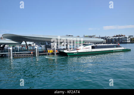 A Sydney Rivercat fast ferry named after swimmer Dawn Fraser approaching Barangaroo Wharf in Darling Harbour, Sydney - Stock Photo