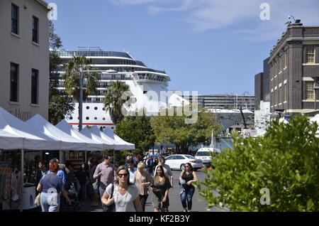 A street market in Argyle Street, Sydney with cruise liner Carnival Spirit in the background moored at Cicular Quay. - Stock Photo