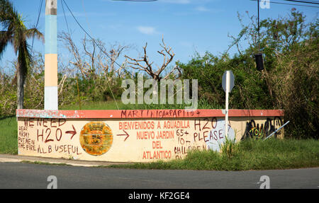 Graffiti on an entrance sign signals residents in need of food and water during relief efforts in the aftermath - Stock Photo