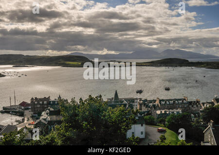 The view over the town of Oban from the folly of McCaig's Tower across the bay and Firth of Lorn to the islands - Stock Photo
