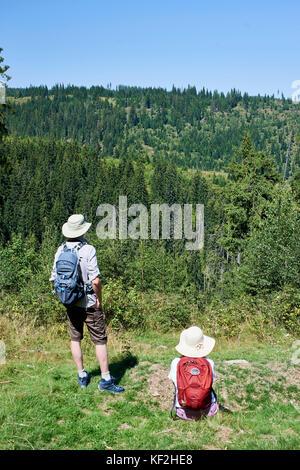 Statiunea Muntele Băișorii (Mountain resort Băişorii), couple out walking rambling in the countryside (Stuart, Linda) - Stock Photo