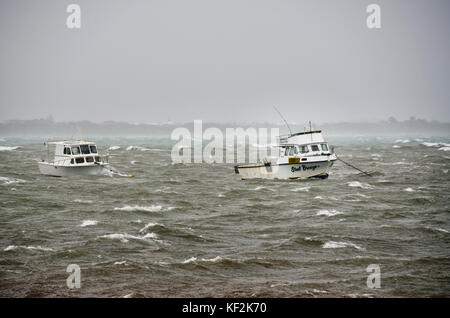 Boats at anchor being battered by severe weather conditions during a storm at Rockingham Western Australia - Stock Photo