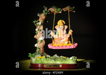 'Lord Ganesha' Image of  Hindu god on a swing. - Stock Photo