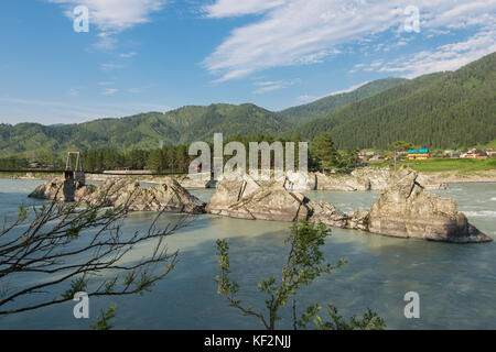 Fast mountain river Katun in Altay, Siberia, Russia. A popular tourist place called the Dragon's Teeth - Stock Photo