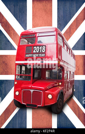 Happy new year 2018 written on a London vintage red bus, Union Jack background - Stock Photo