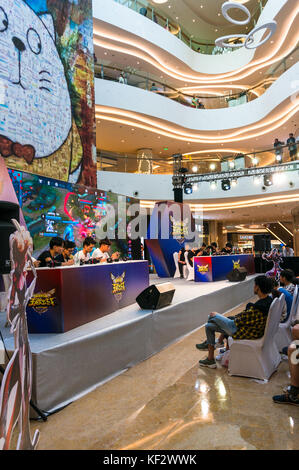 Real time video game competition, teams of 5 vs 5, in Shenzhen, China - Stock Photo