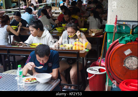 22.10.2017, Singapore, Republic of Singapore, Asia - People eat in one of the many restaurants at the Chinatown - Stock Photo
