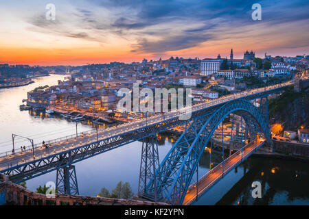 Porto river cityscape, view of the skyline of the city of Porto at dusk with the Ponte Dom Luis I bridge in the - Stock Photo