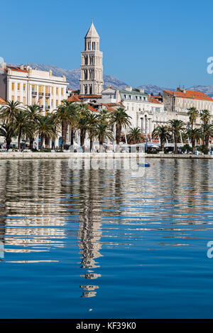 Cathedral of St Domnius reflects in the water off the tree-lined Riva on Split's waterfront.
