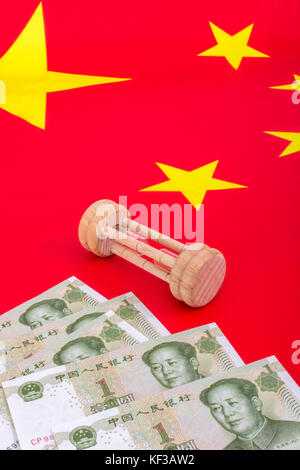 Chinese flag + small egg timer & Yuan banknotes. Metaphor Chinese growing debt problem / crisis, China time running - Stock Photo