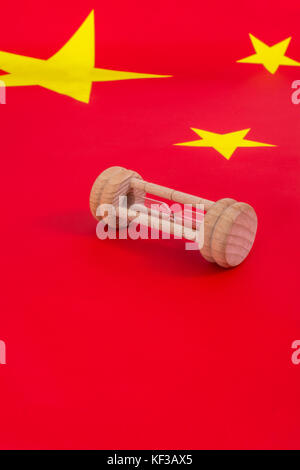 Chinese flag with small egg timer - metaphor for Chinese growing debt problem / crisis and time running out on financial - Stock Photo