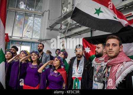 Syrian people wave the national flag at the 2017 World Festival of Youth and Students in the Olympic Park's main - Stock Photo