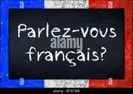 Parlez-vous francais  (translation: do you speak french) language education concept on chalkboard blackboard with - Stock Photo