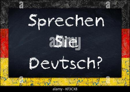 sprechen sie deutsch (translation: do you speak german) language education concept on chalkboard blackboard with - Stock Photo