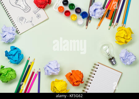 New idea concept with crumpled office paper and light bulb - Stock Photo