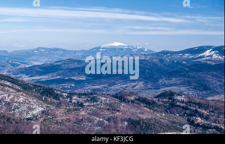 view to Babia Gora hill with lowest hills around in Zywiec Beskids mountains from Barania Gora hill in Silesian - Stock Photo