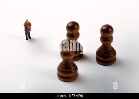 business strategy concept - businessman standing in front of chess pieces - Stock Photo