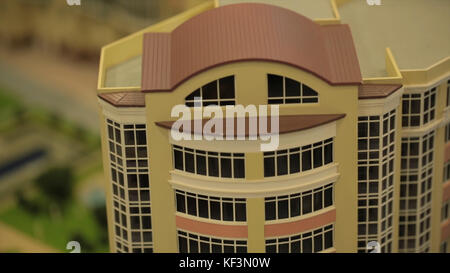 Miniature model,miniature building,city. Model Towns. Miniature model, miniature toy buildings, cars and people. - Stock Photo