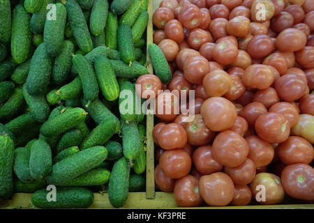 cucumbers tomatoes sold in the store - Stock Photo