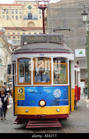 The old trams still form part of Lisbon's day to day transport system - Stock Photo