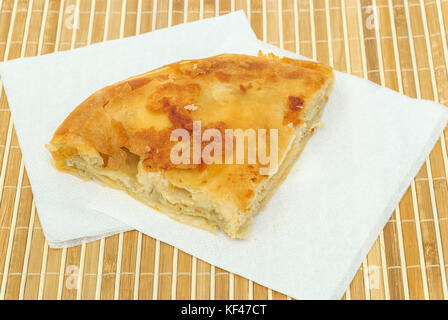 burek or pie with cheese on a paper serviettes - Stock Photo