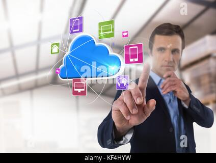 Digital composite of Cloud app interface and Businessman touching air in front of warehouse - Stock Photo