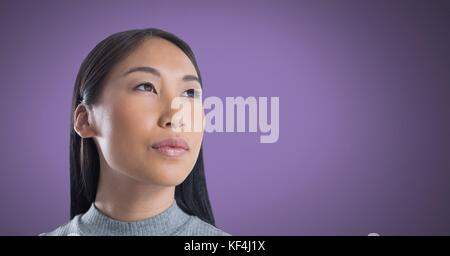 Digital composite of Woman looking up with purple background - Stock Photo