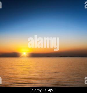Beautiful sunset over Lake Ellesmere, Canterbury, New Zealand - Stock Photo