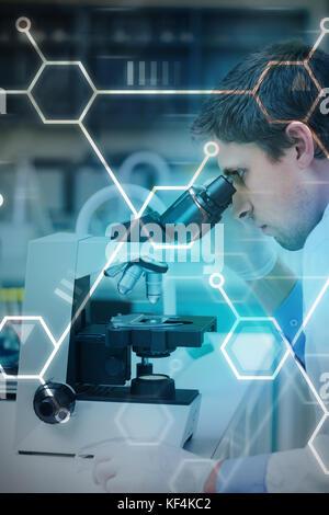 Digital data  against scientific researcher using microscope in the laboratory - Stock Photo
