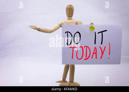 A Conceptual yellow Hand writing caption inscription written sticky note with word Do It TODAY With black ink on - Stock Photo
