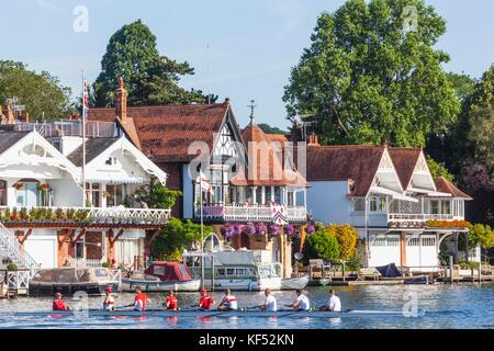 England,Oxfordshire,Henley-on-Thames,Boathouses and Rowers on River Thames - Stock Photo