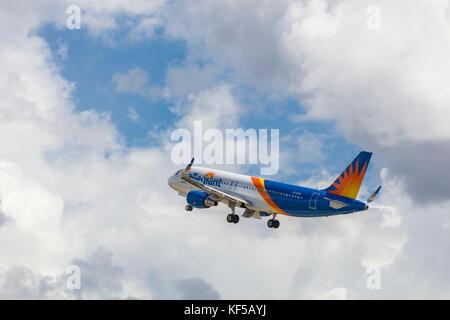 Allegiant commercial passenger airliner taking off at Punta Gorda Florida airport - Stock Photo