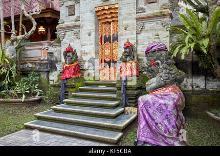 Carved stone statues in Puri Saren Agung, also known as Ubud Palace. Ubud, Bali, Indonesia. - Stock Photo